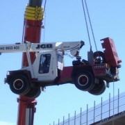 Lifting a smaller crane at the Mt Henry Bridge Duplication